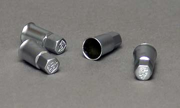 Valve stem caps with crest